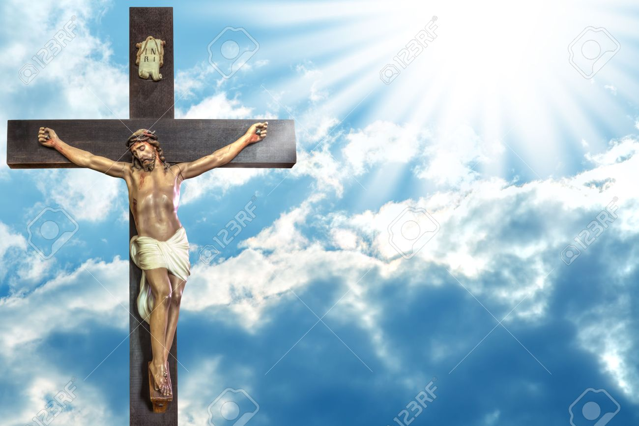 Jesus Christ to paradise: cross of Jesus Christ on sky background with a shining celestial light from above. - 42248411