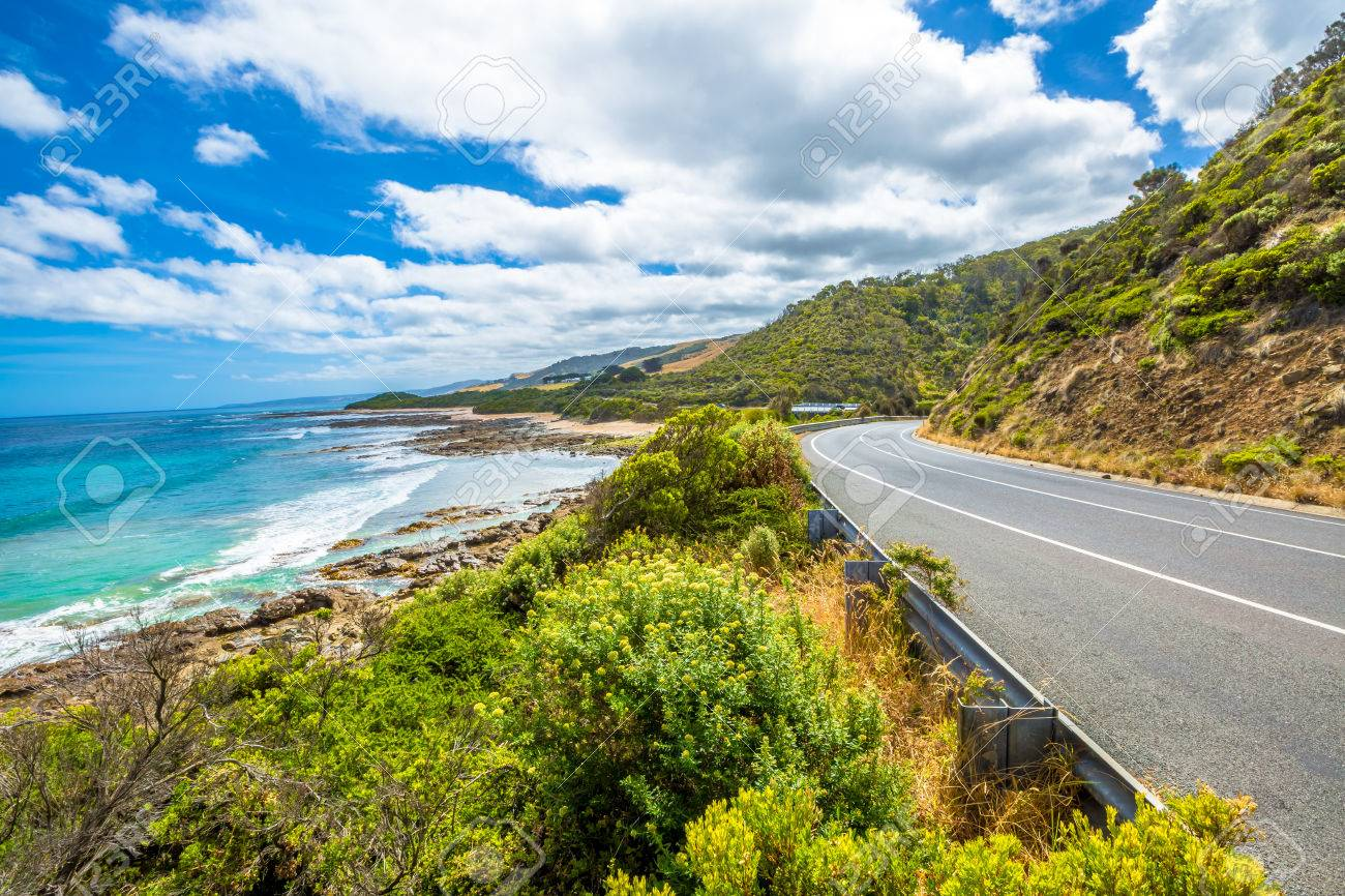 Great Ocean Road with its famous mountains, the winding road, cliffs, rocky beaches, the turquoise sea and its waves for surfing. - 42880799