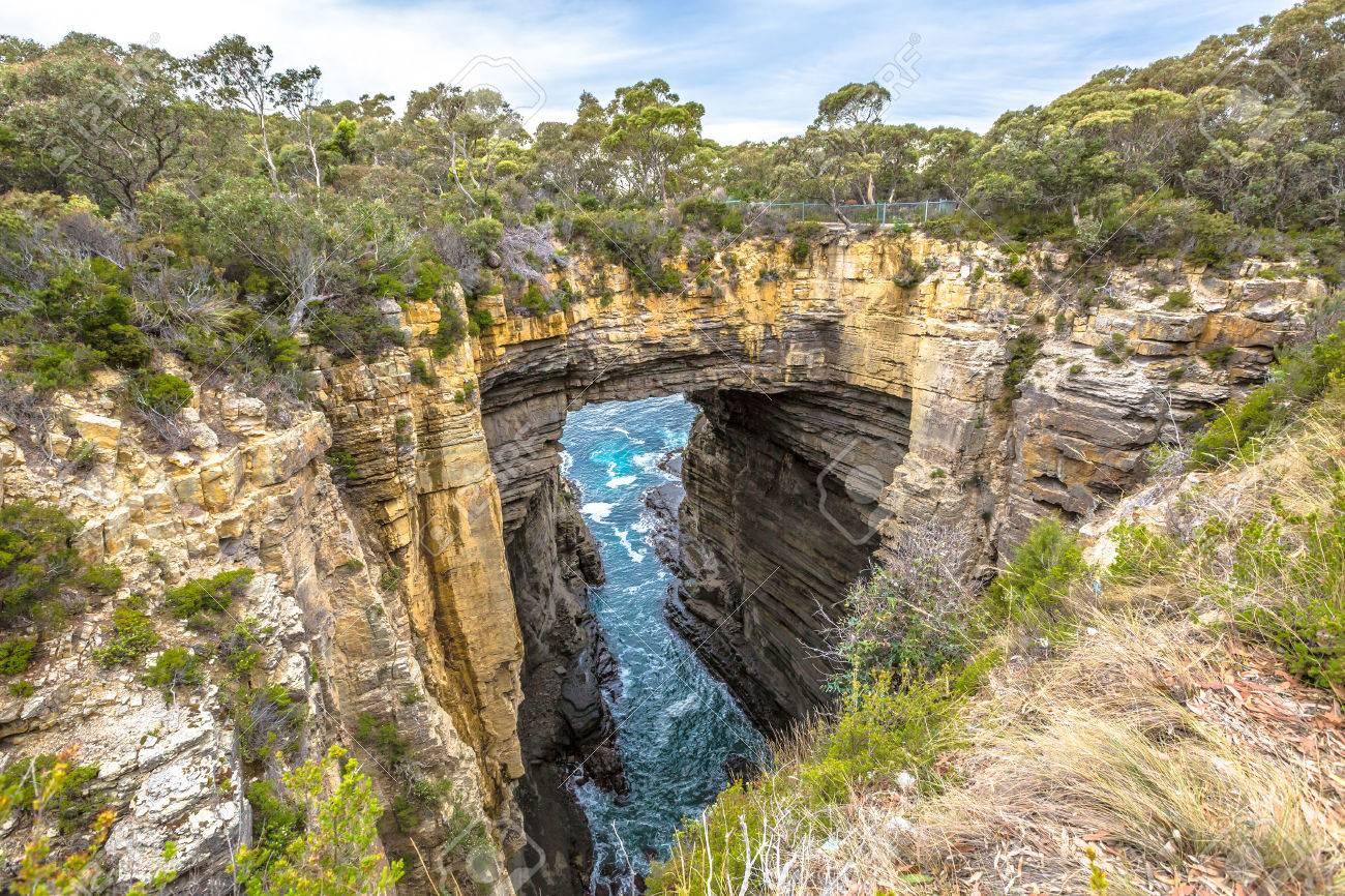 Tasman Arch is an unusual geological formation found in the Tasman National Park, Tasman Peninsula in the south east coast of Tasmania, Australia. Stock Photo - 42879494