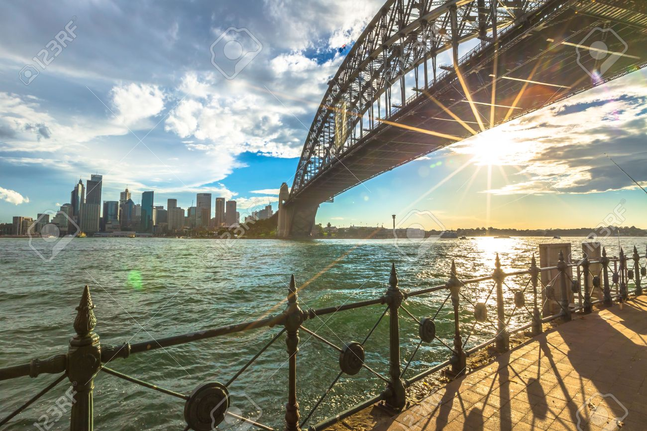 Spectacular Sydney Skyline at sunset. Walking on the path that leads beneath the Sydney Harbour Bridge, New South Wales, Australia. - 42886149