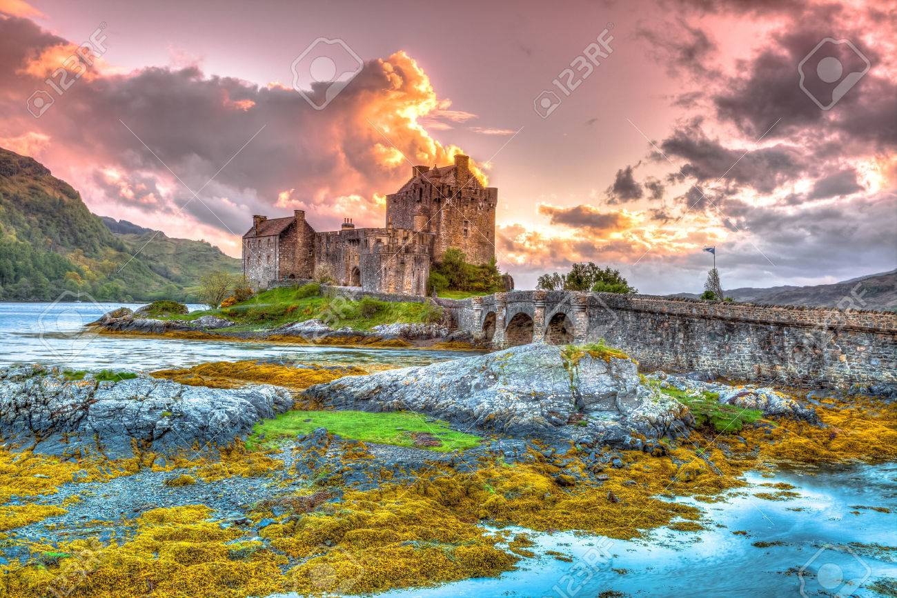 Eilean Donan Castle at sunset, Dornie, Kyle of Lochalsh in Scotland, United Kingdom. It is the most visited castle, situated on an island at the confluence of three sea lochs. Stock Photo - 45711527