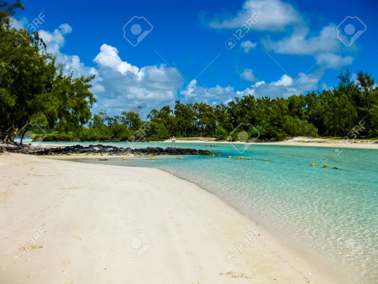 The spectacular and idyllic white beach of Deer Island near Bellemare, located on the east coast of Mauritius, one of the main attractions. Stock Photo - 47559338