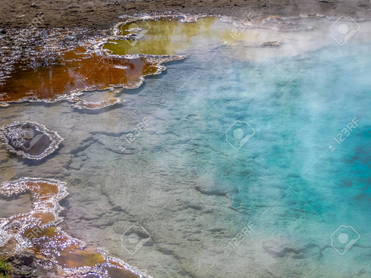 Closeup hot spring with steam in Yellowstone National Park, Wyoming and Montana, United States. Stock Photo - 47791082