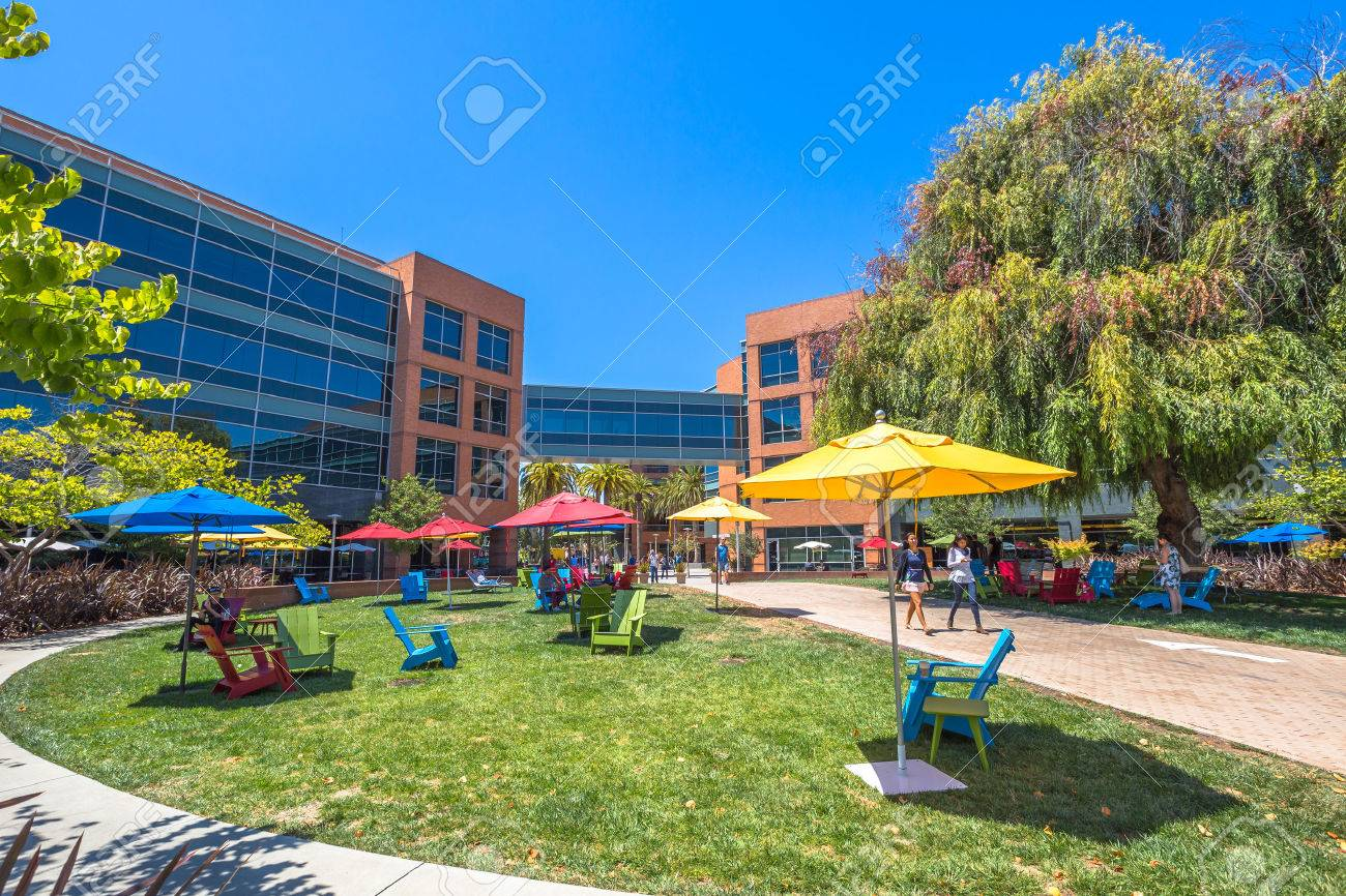 Mountain View, CA, USA - August 15, 2016: Google employees walking in relaxing area at Google's headquarters or Googleplex. Google is a multinational company specializing in Internet-related services. - 63166628
