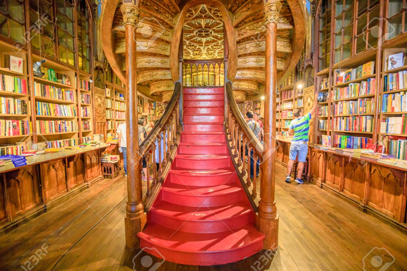 Oporto, Portugal - August 13, 2017: large wooden staircase with red steps inside Library Lello and Irmao in historic center of Porto, famous for Harry Potter film. Horizontal shot. - 111473446
