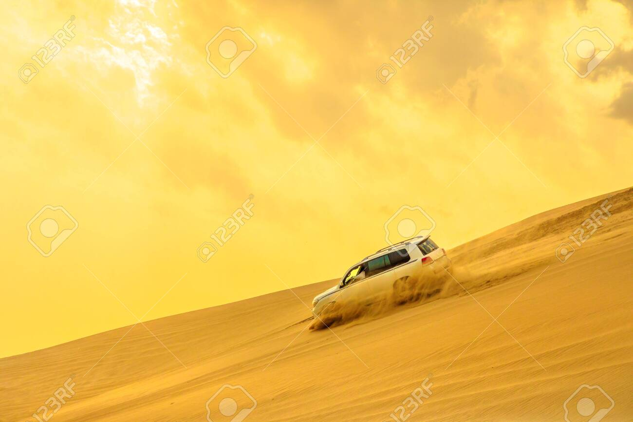 Dune Bashing at sunset sky near Qatar and Saudi Arabia. Khor Al Udeid, Persian Gulf, Middle East. Inland sea is a major tourist destination for Qatar. Discovery and adventure travel concept. - 123030355