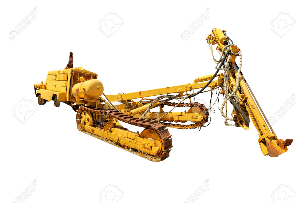 Tracked bulldozer with drilling machine for work along road. Work in progress, industrial machine. Isolated on white background with copy space. - 137787803