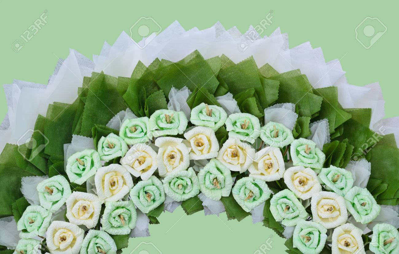 Roses flower wreath for use in thai funeral on green background roses flower wreath for use in thai funeral on green background with working path stock photo izmirmasajfo Gallery
