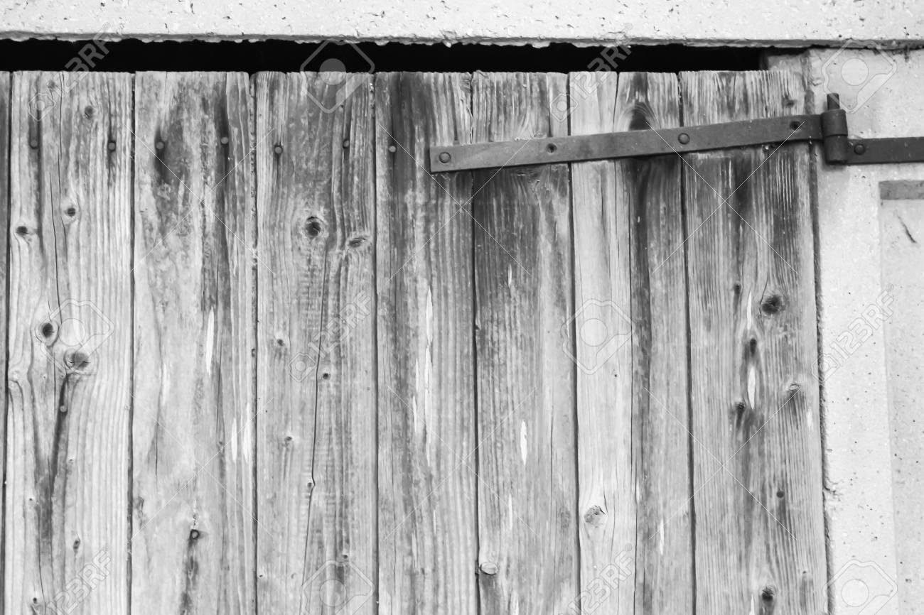 Old Barn Door With A Rusty Metal Hinge In My Back Yard Stock Photo    86133376