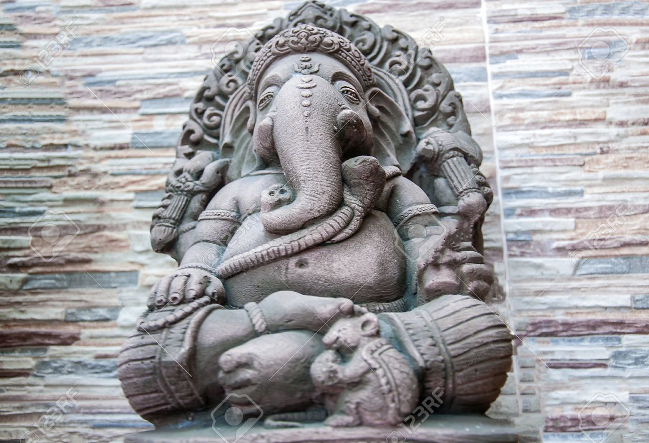 Hindu god ganesh statue with stone background stock photo picture
