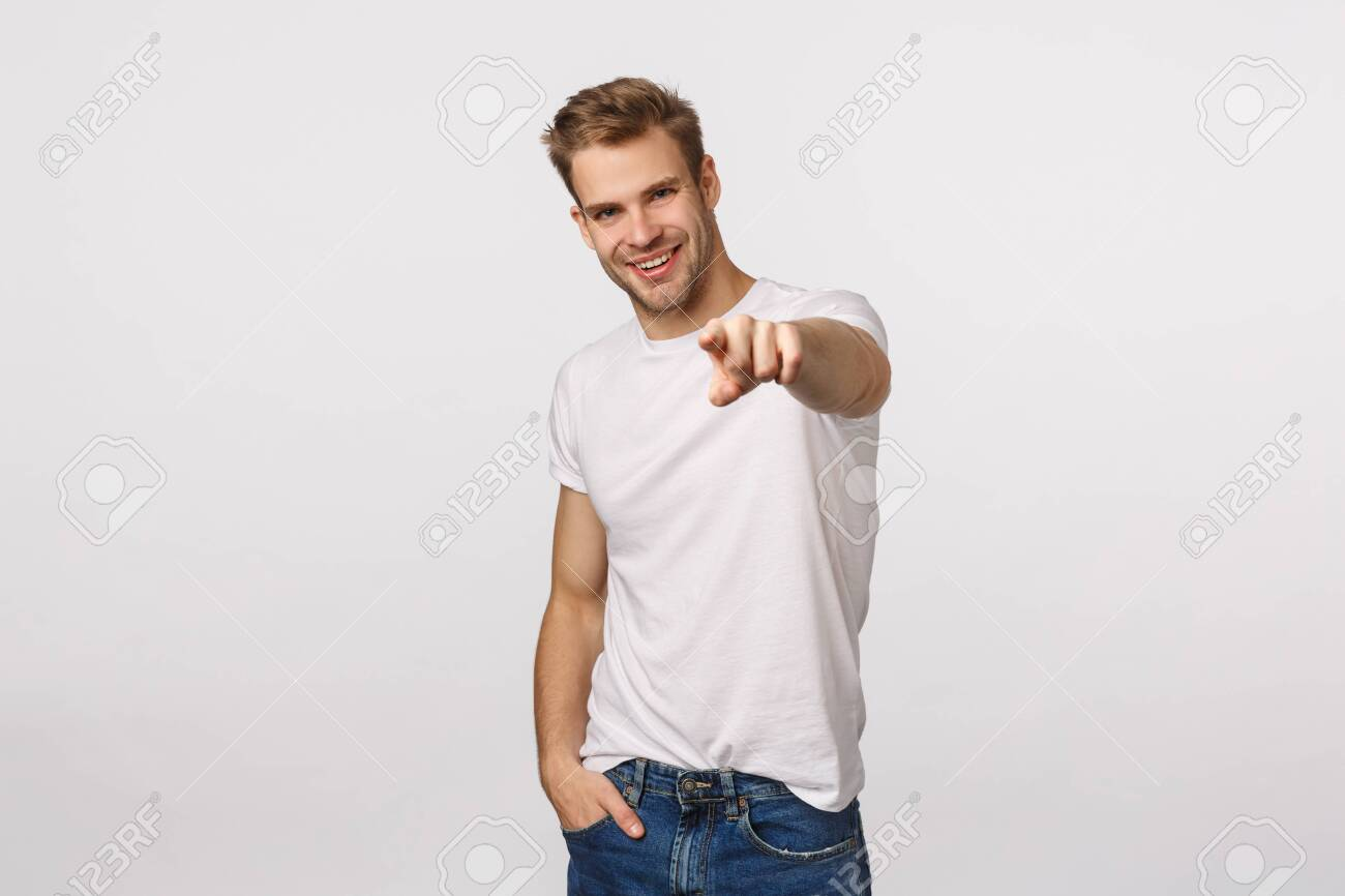 We need you, come here. Attractive and assertive, confident sassy blond guy looking for employees, pointing finger at camera and smiling pleased, found excellent person for company vacancy - 135681956