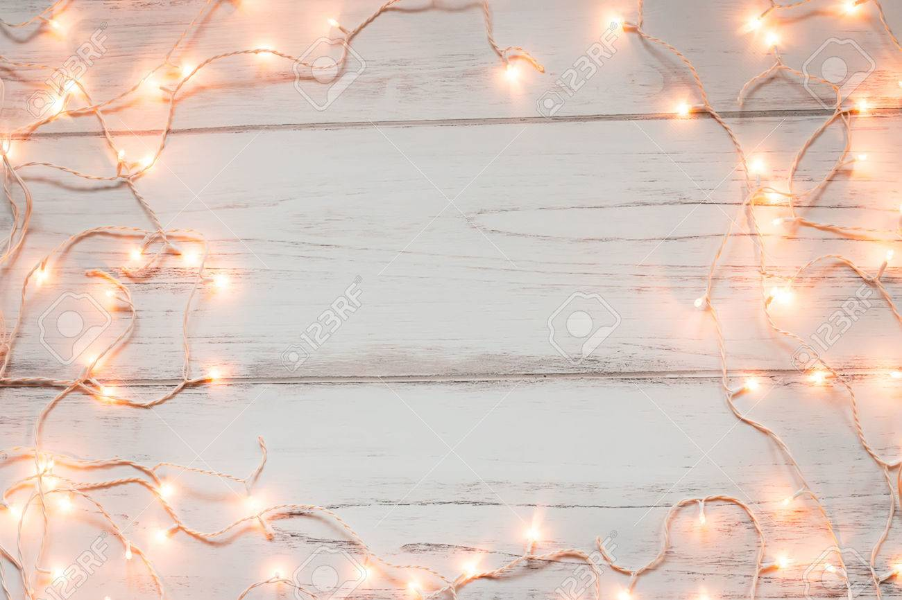 Christmas Lights Wooden Background With Space For Text Stock Photo