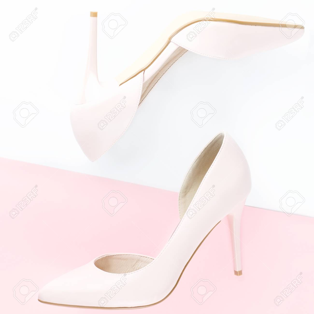 f3addf02ec8 Woman pale pink pumps on pink and white background. Top view,..