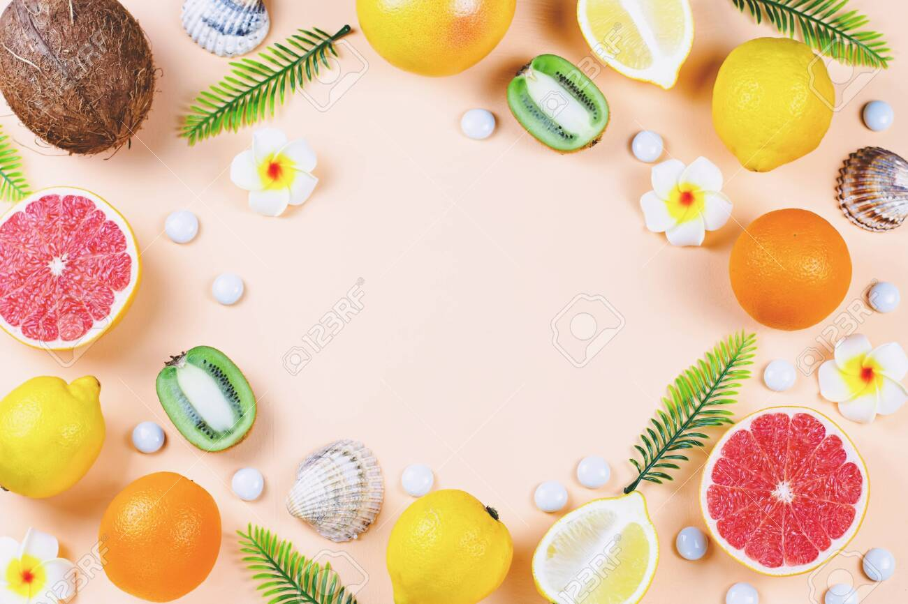Colorful summer concept flat lay with fresh juice, tropical fruits,