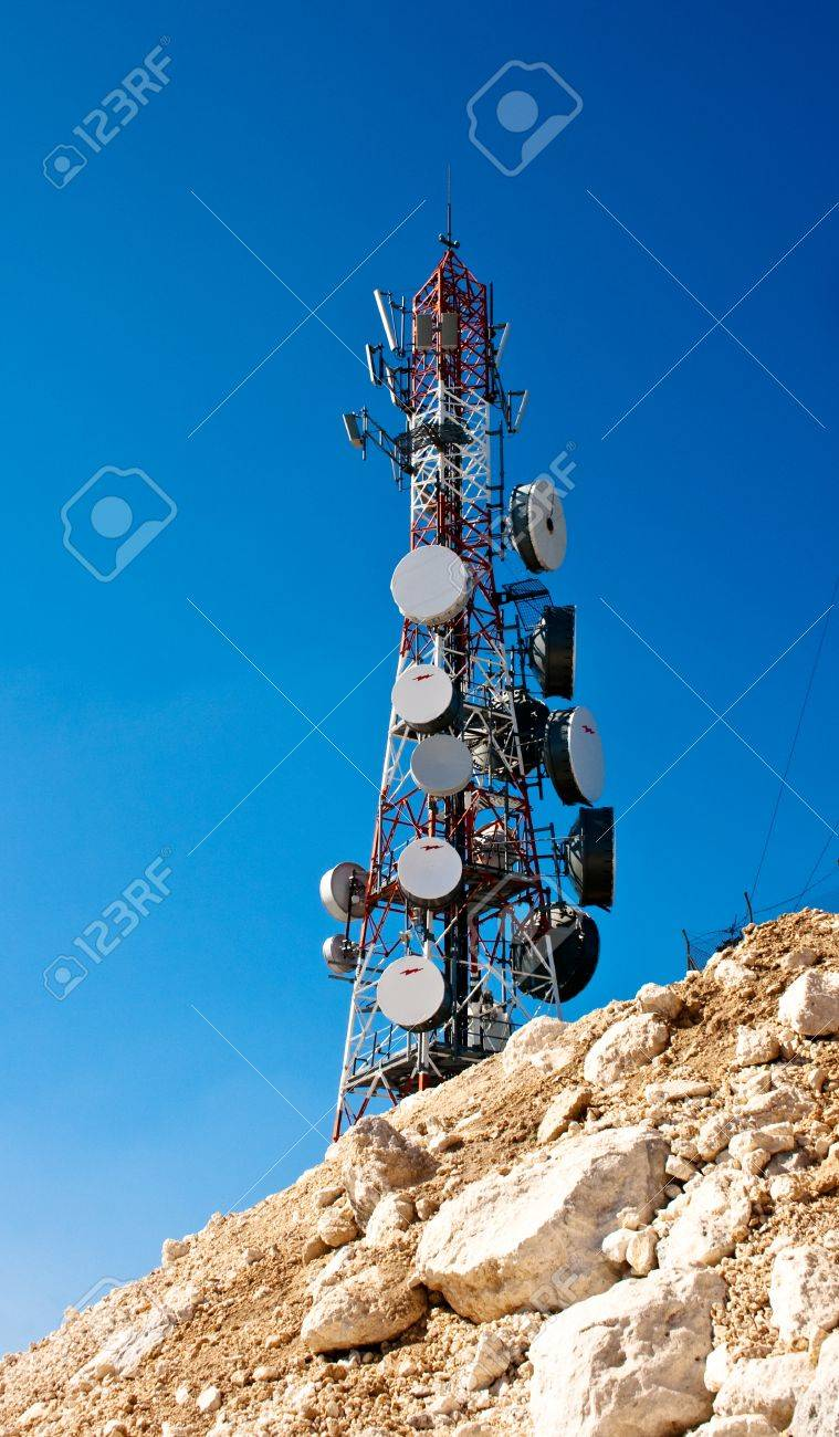 Modern cell and antenna with flat parabola on blue sky Stock Photo - 9983797