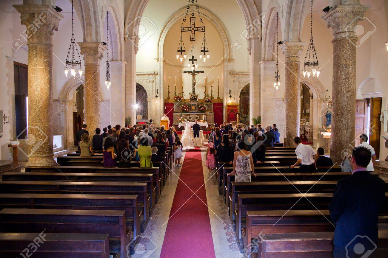 Interior of a christian church with a couple getting married Stock Photo - 10499569