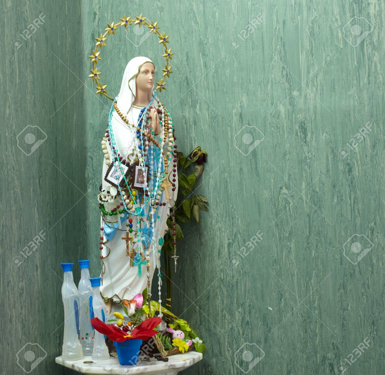 Statue of Virgin Mary covered with rosaries Stock Photo - 11035405