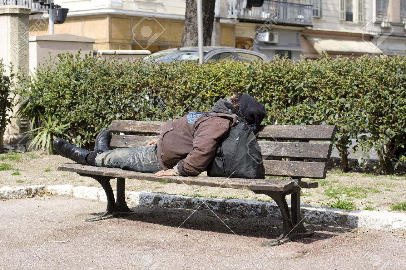 Homeless sleeping on the bench Stock Photo - 20691521