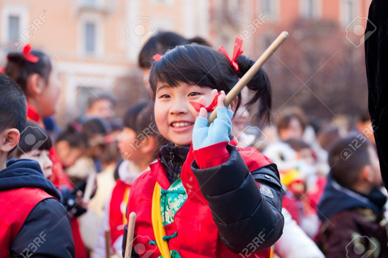 MILAN, ITALY - FEBRUARY 10: Child in traditional costume in the Chinese New Year parade in Milan on February 10, 2013 Stock Photo - 17951467