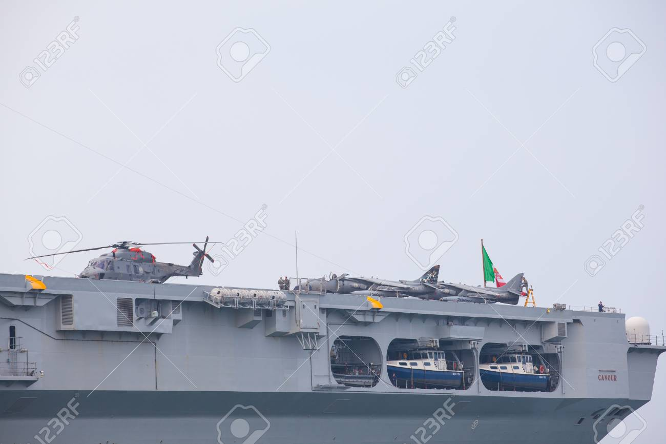 33230489-trieste-italy-november-02-view-of-the-portaerei-cavour-the-italian-aircraft-carrier-and-the-newest-f.jpg