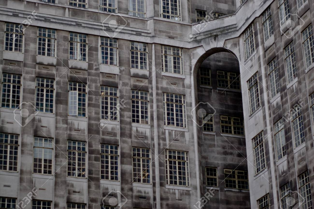 looking at the grey facade of an art deco office building in london stock photo art deco office building