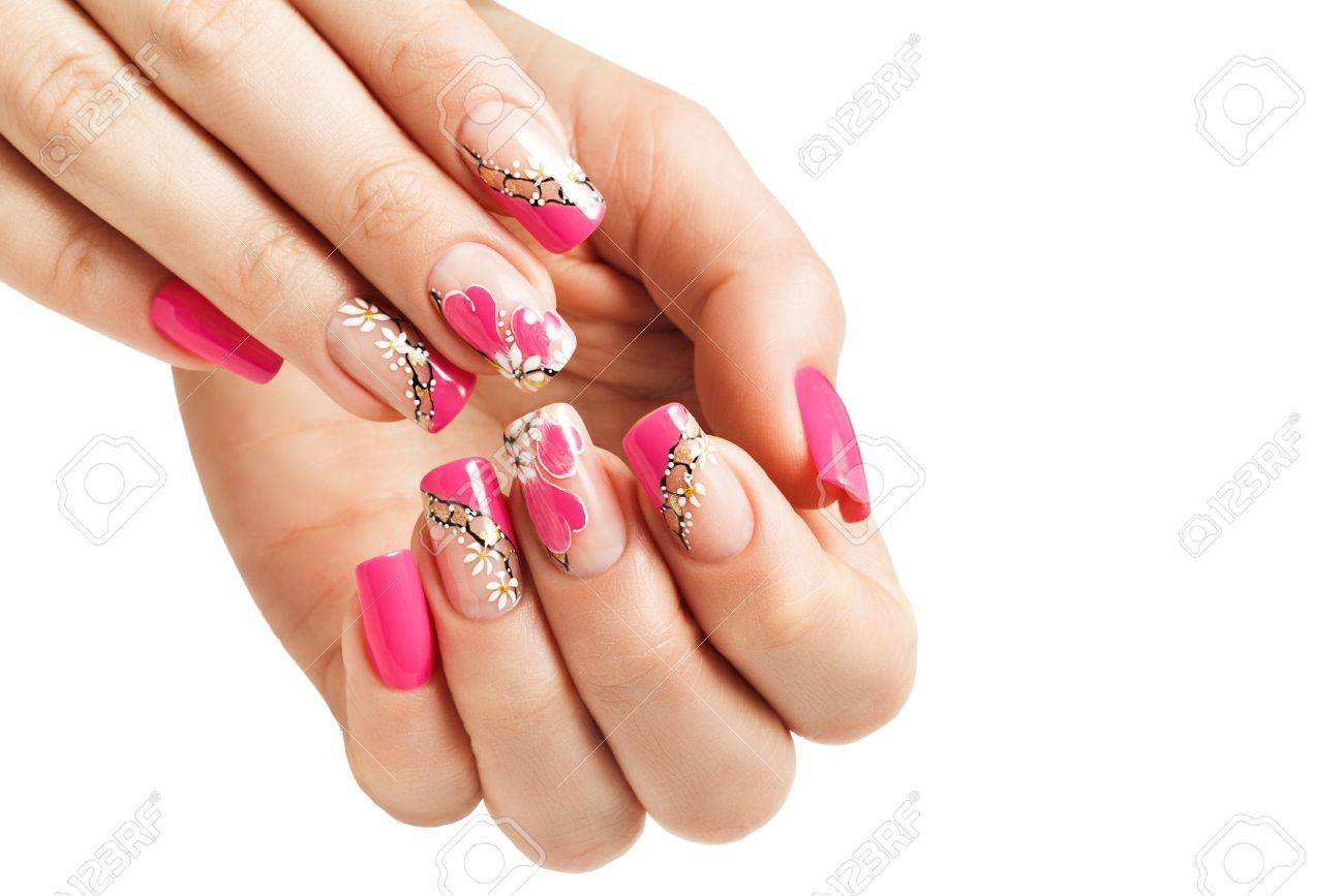 Nail Art Manicure With A Pattern Of Flowers And Hearts Isolated