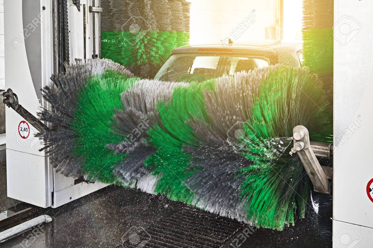 Automatic indoor car wash service in action - 121638508