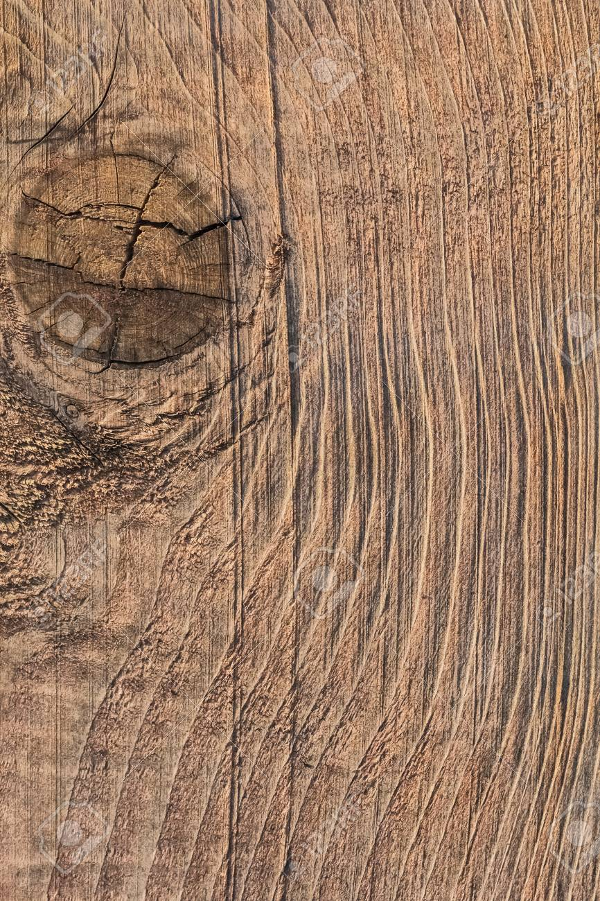 photograph of old roughly treated weathered cracked floorboard