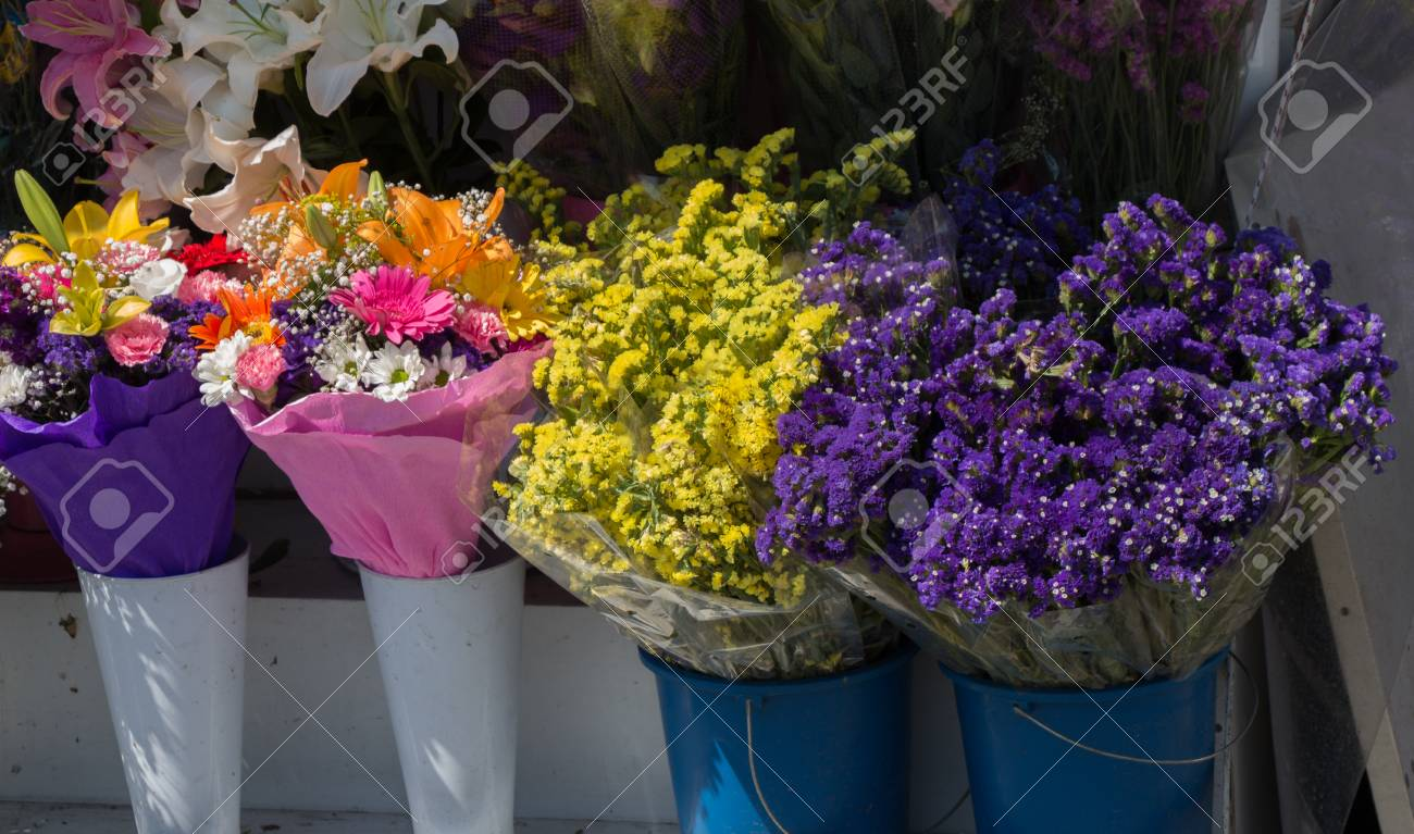 Beautiful Flowers Of Various Types In A Flower In Vase Stock Photo