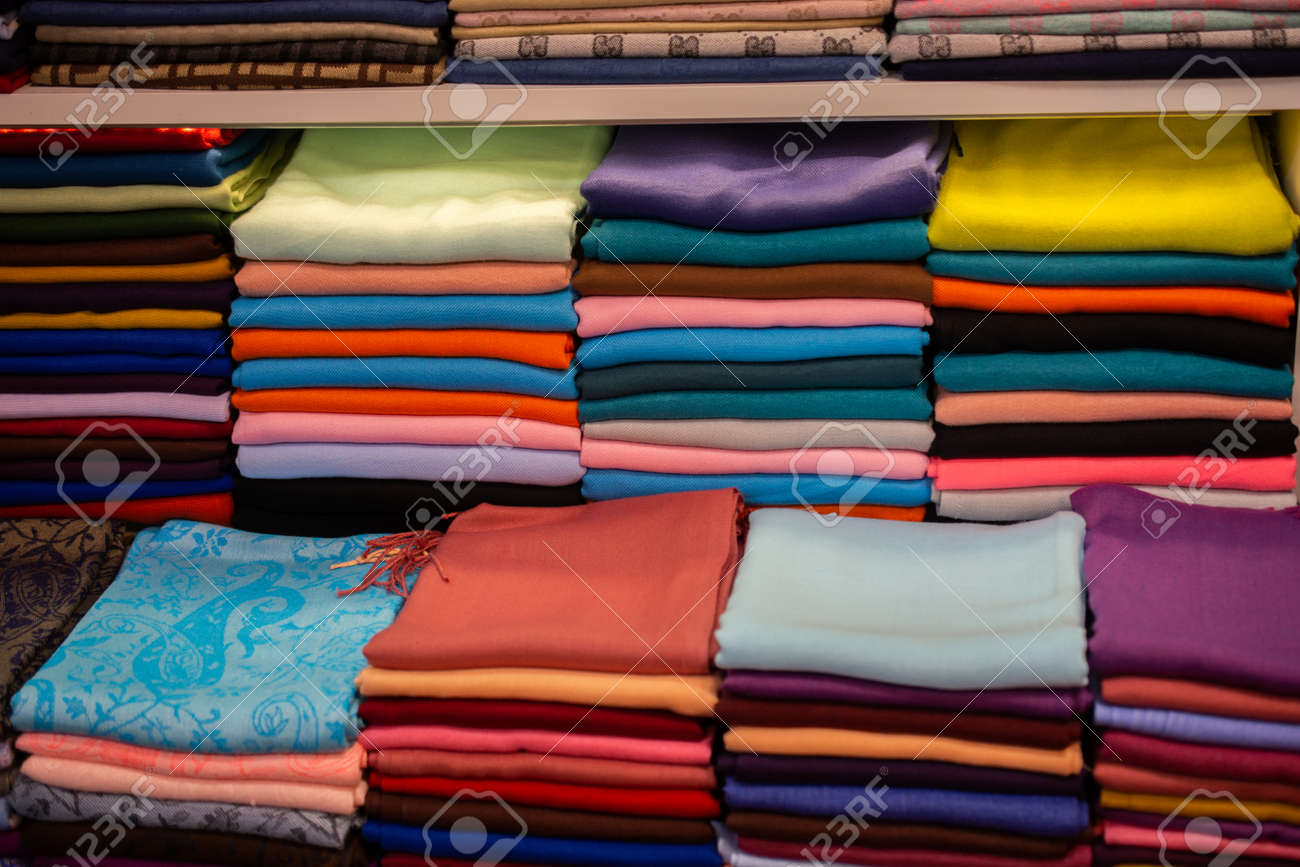 Pile of bright Multi-colored pieces of fabric in a bazaar - 159609529