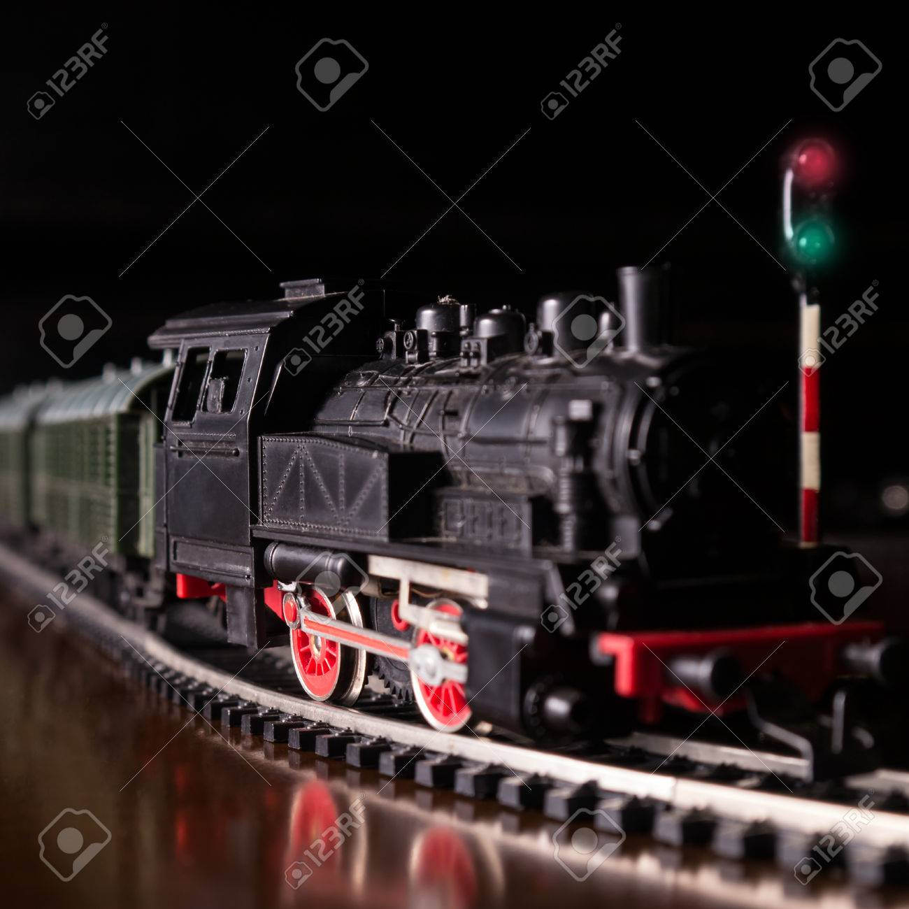 model railroad with steam locomotive by night