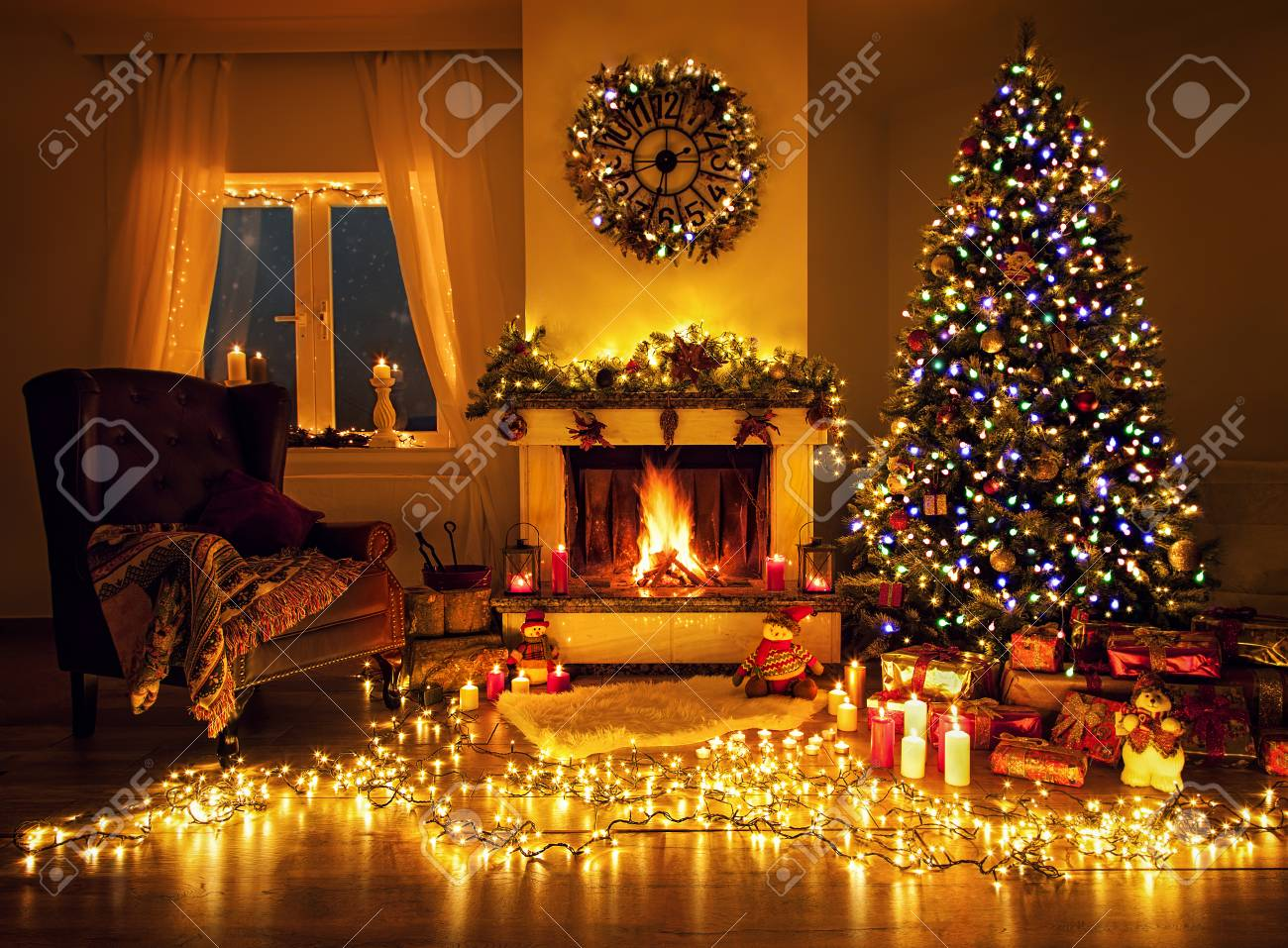Beautiful decorated living room with a christmas tree and a fire..