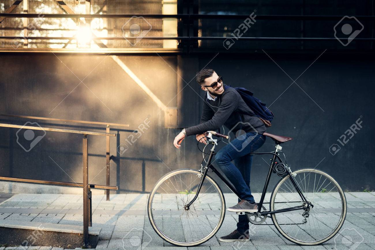 A young stylish businessman going to work by bike. Stock Photo - 46239338