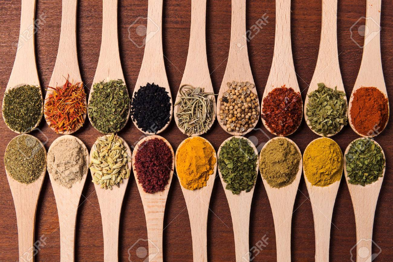 Cropped shot of spoons filled with a variety of spices. - 46449055
