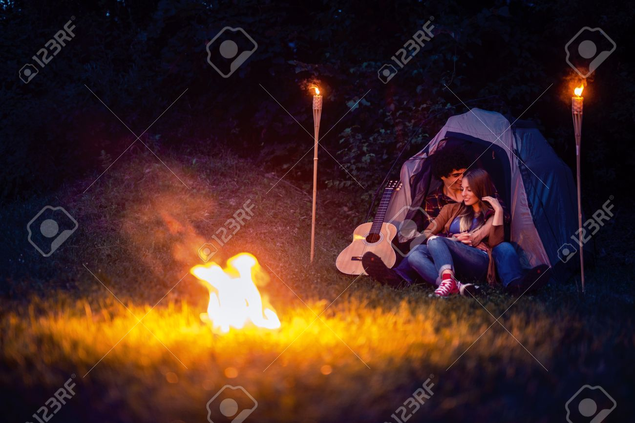 Couple in love enjoying a romantic night camping stock photo 75449949