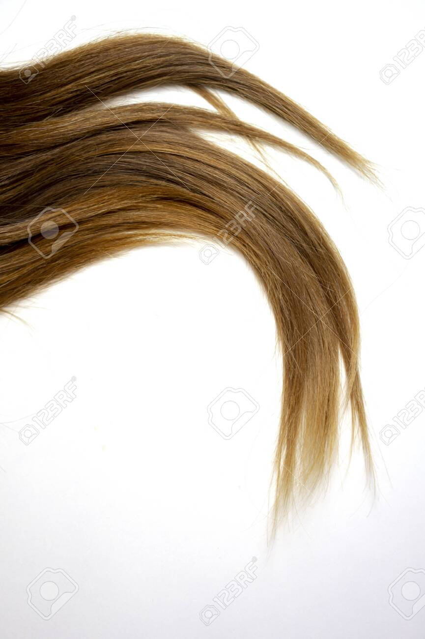 long brown straight hair on white isolated background with balayage..