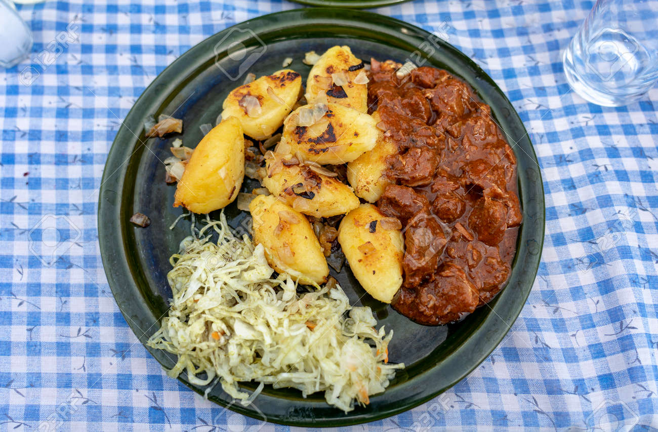 traditional hungarian Őrség style Dödölle pastry potato dumpling with pörkölt stew and cabbage - 160670555