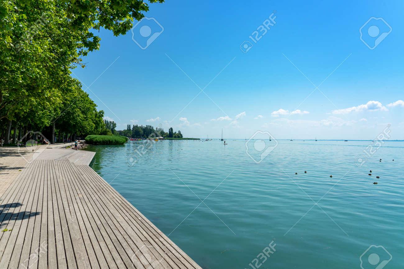 Promenade in Balatonfüred next to Lake balaton with wooden lakeside - 163079217