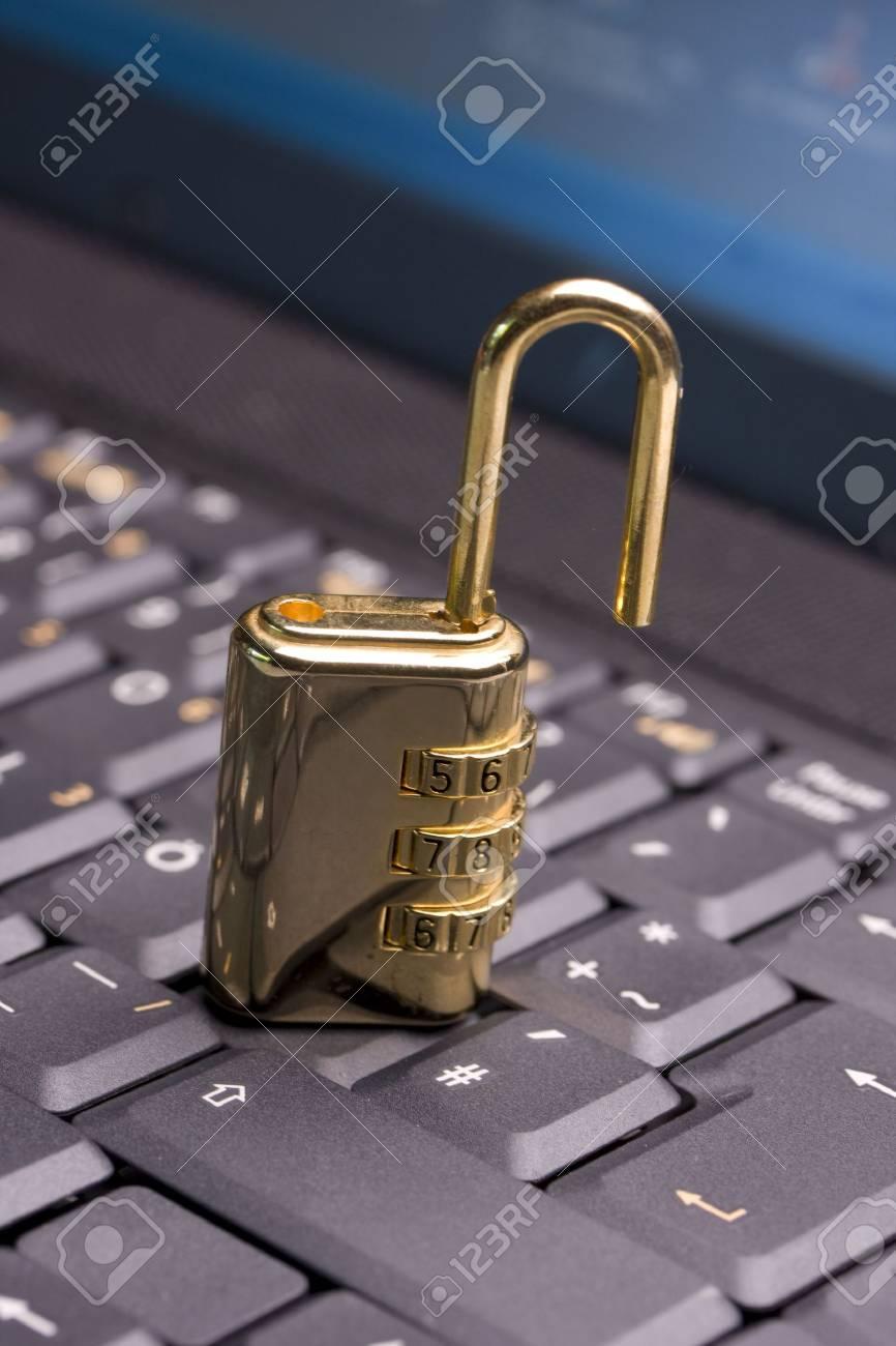 a golden padlock on a black notebook keyboard Stock Photo - 3534030