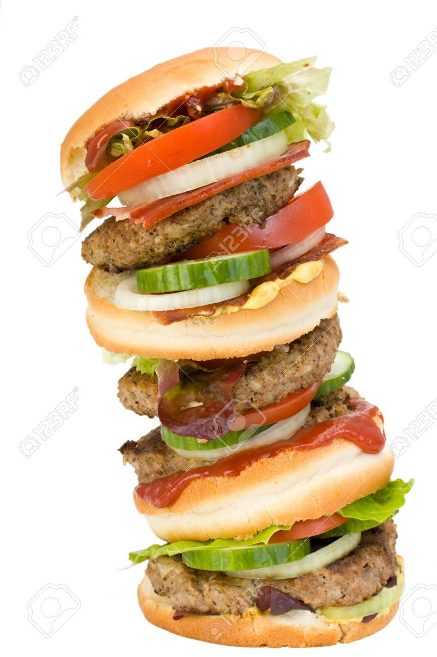 a home made quadruple hamburger isolated on white background Stock Photo - 3793075