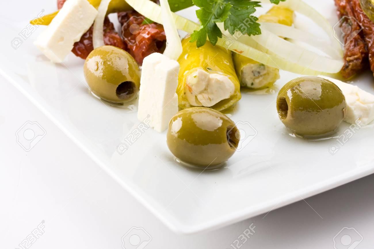 white plate with antipasti - olives, tomatos and peperoni Stock Photo - 3905055
