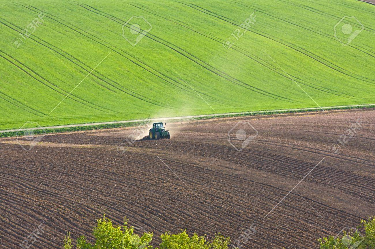 tractor throwing up dust on farmland Stock Photo - 4833119