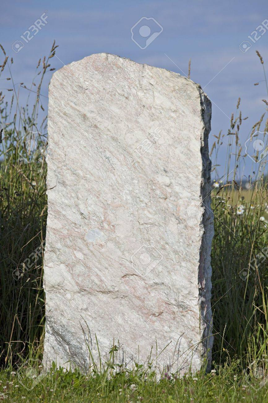 single empty granite gravestone on a grass meadow Stock Photo - 5131084