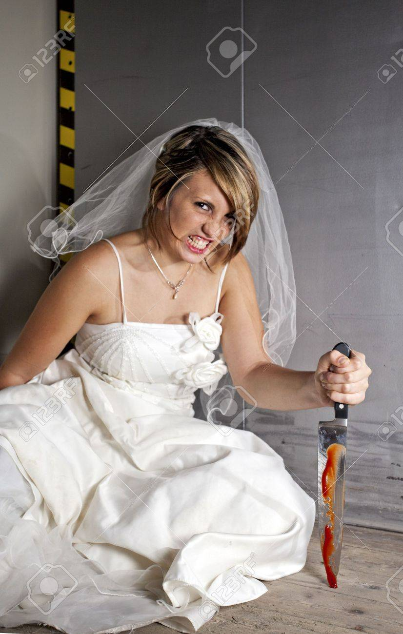 angry young bride with a bloody knife in an elevator Stock Photo - 5729910