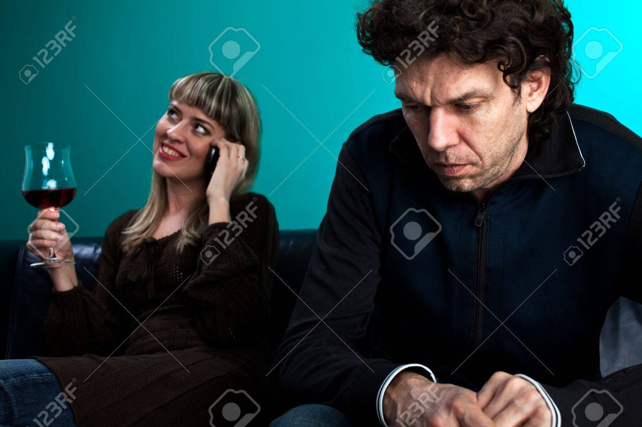 woman talking on the phone and a frustrated man Stock Photo - 6608617