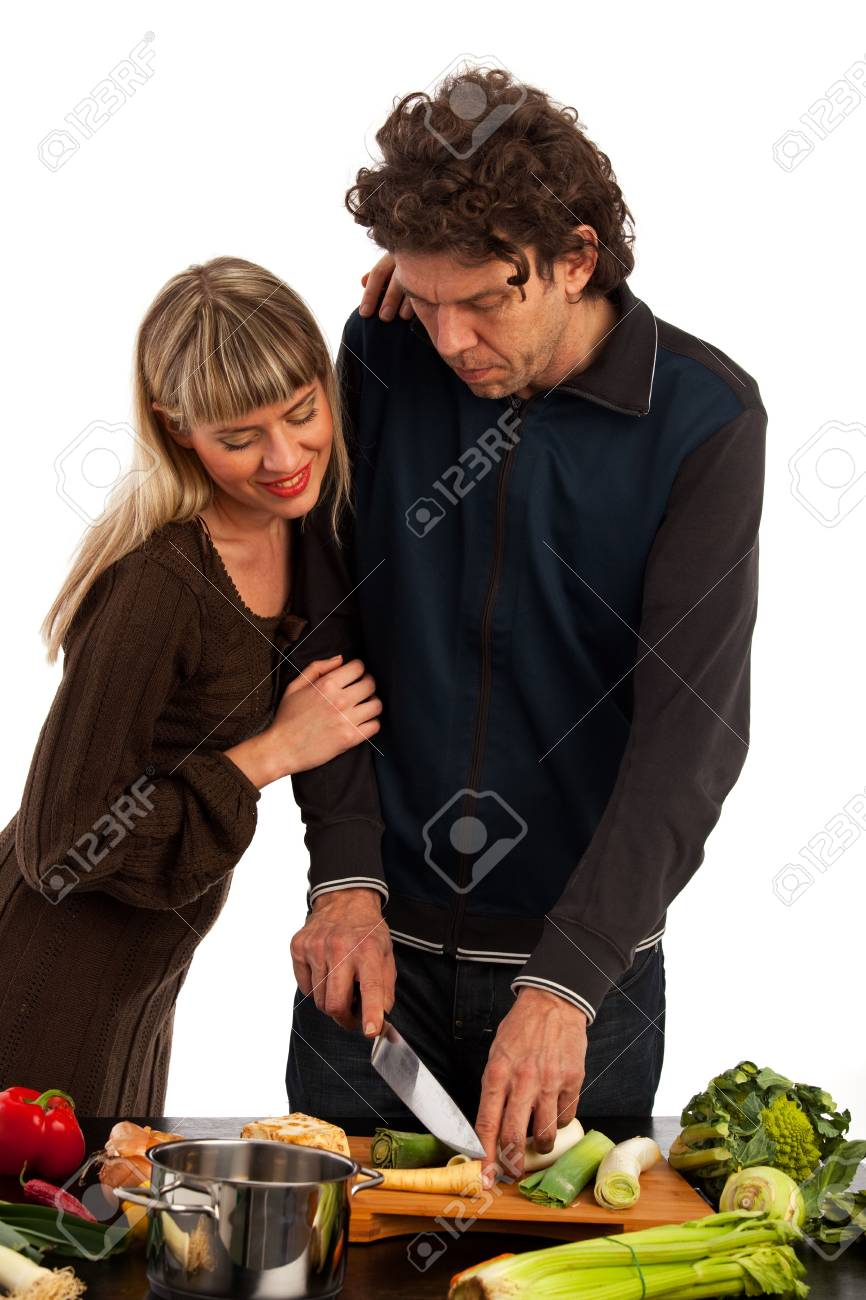 happy couple cooking insolated on white Stock Photo - 6608637