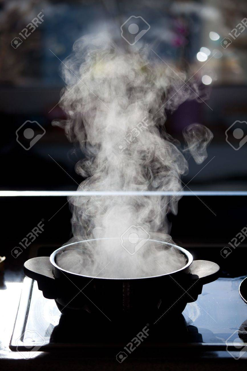 steam rising off a boiling pot Stock Photo - 8695340