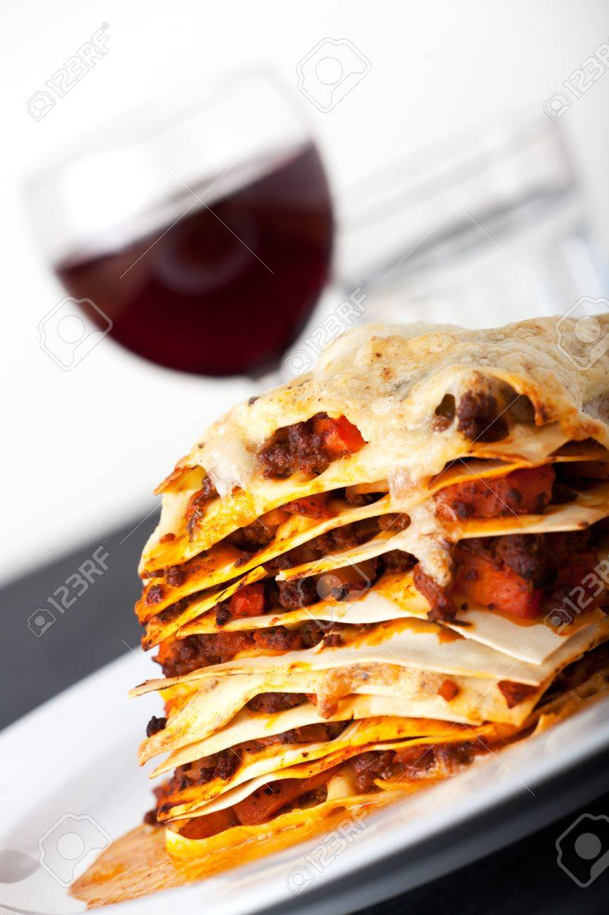 closeup of lasagna with red wine Stock Photo - 8819023