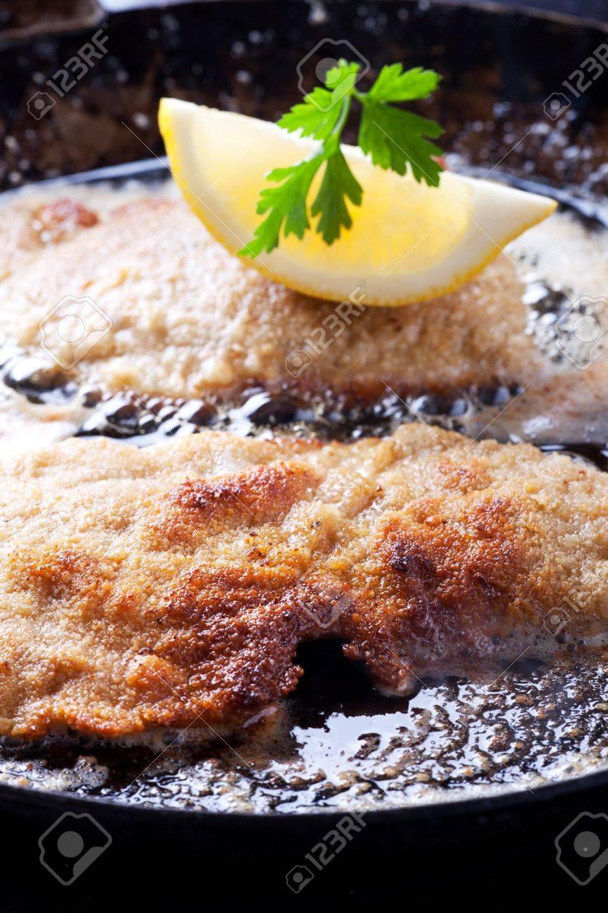 wiener schnitzel frying in a pan Stock Photo - 10560157