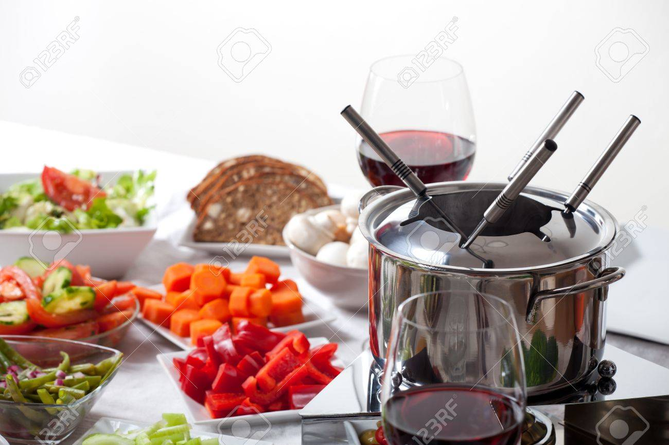 table with fondue set and ingredients Stock Photo - 11762528